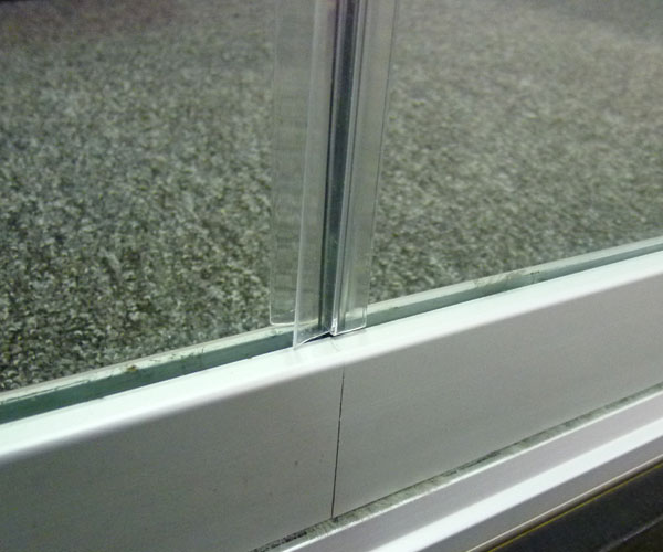 Close up of a typical closed glass panel seam condition on the COVER glass enclosure.