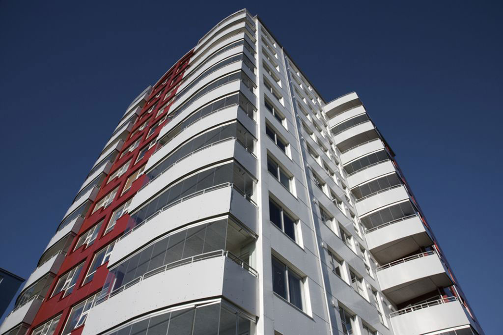 An apartment building using COVER glass systems exclusive for all balcony enclosures.
